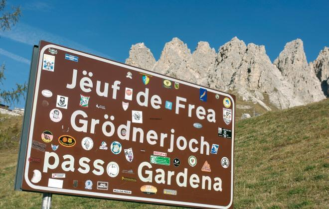 Place name sign at the Gardena ridge in South Tyrol
